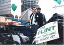 Flint rides in the St. Patrick's Day Parade downtown, campaigning for office.