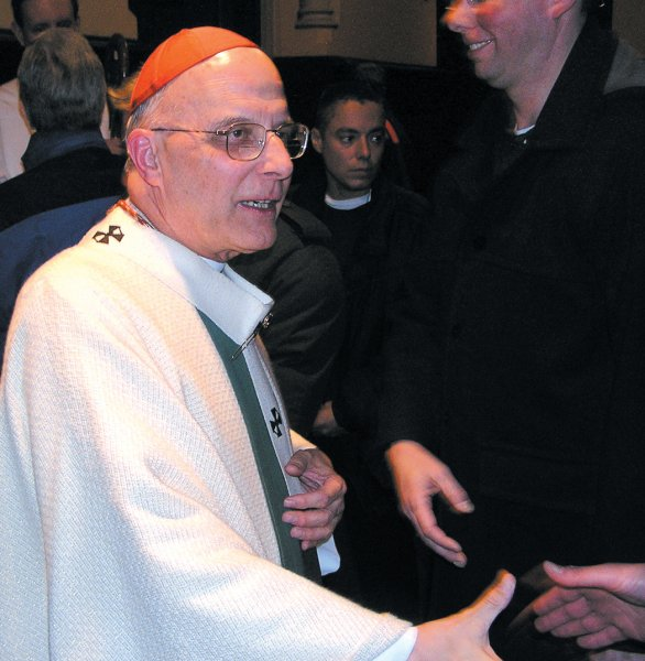 Cardinal George greets members of the Archdiocesan Gay and Lesbian Outreach at mass Sunday, Feb. 8, 2004 at Mt. Carmel on Belmont. Photo by Tracy Baim