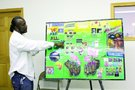 Outreach supervisor Harold Cherry shows off his education board.