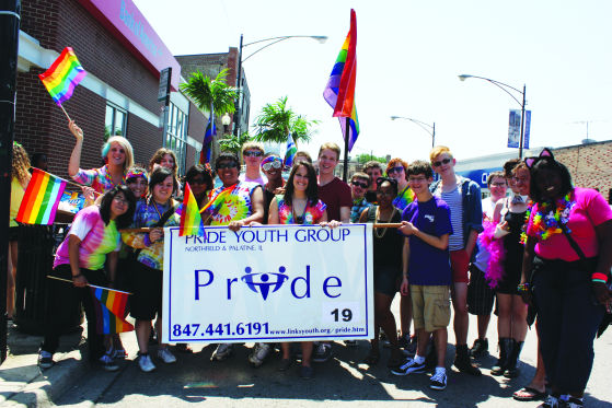 Members at Pride Parade. Photo by De Leon
