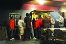 People line up for Sunday's Safe Haven dinner, which is cooked by church volunteers. Photo by Bill Healy.