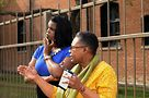 Cook County State's Attorney candidate Kim Foxx with Kim Hunt at the tiny home model, next to the Jane Addams Hull House. Photo by Hal Baim