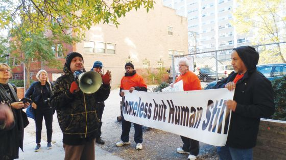 Protestors march in Uptown for tent-city residents