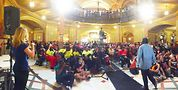 Shani chants before crowd in the capitol building rotunda. Photo by Tracy Baim