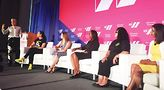 LGBTQ attorney-activist Nabeela Rashid (left) and a panel of women regarding business, technology and labor. Photo by Tracy Baim