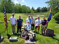 Chris White, Jim Darby, Mr. Clausen, Pat Bova, David Reithoffer, Larry Simpson, Dorothy Hadjys-Clausen at the grave of Allen Schindler, a sailor who was murdered in 1992 by shipmates for being gay. Photo courtesy AVER Chicago