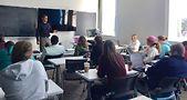 Visiting scholar Austin Baidas addresses pulic policy class. Photo by Sonny Gast