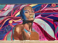 Queer-Brown-femme-power-radiates-at-new-Boystown-mural