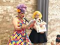Muffy Fishbasket (left) reads while Sutton holds up the pictures for the audience.Photo by Matt Simonette