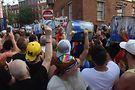 FOGO Azul, all women Brazilian Samba Reggae, drumline entering the crowd. Photo by Darlene Photographics