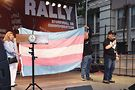Trans-pride flag creator Monica Helms presenting Stonewall Inn co-owners Kurt Kelly and Stacy Lentz with flag. Photo by Sam Estep for Target Cue