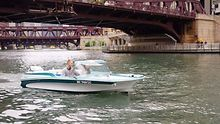 ACTIVITIES-Rollin-on-the-river-courtesy-of-the-Chicago-Electric-Boat-Company